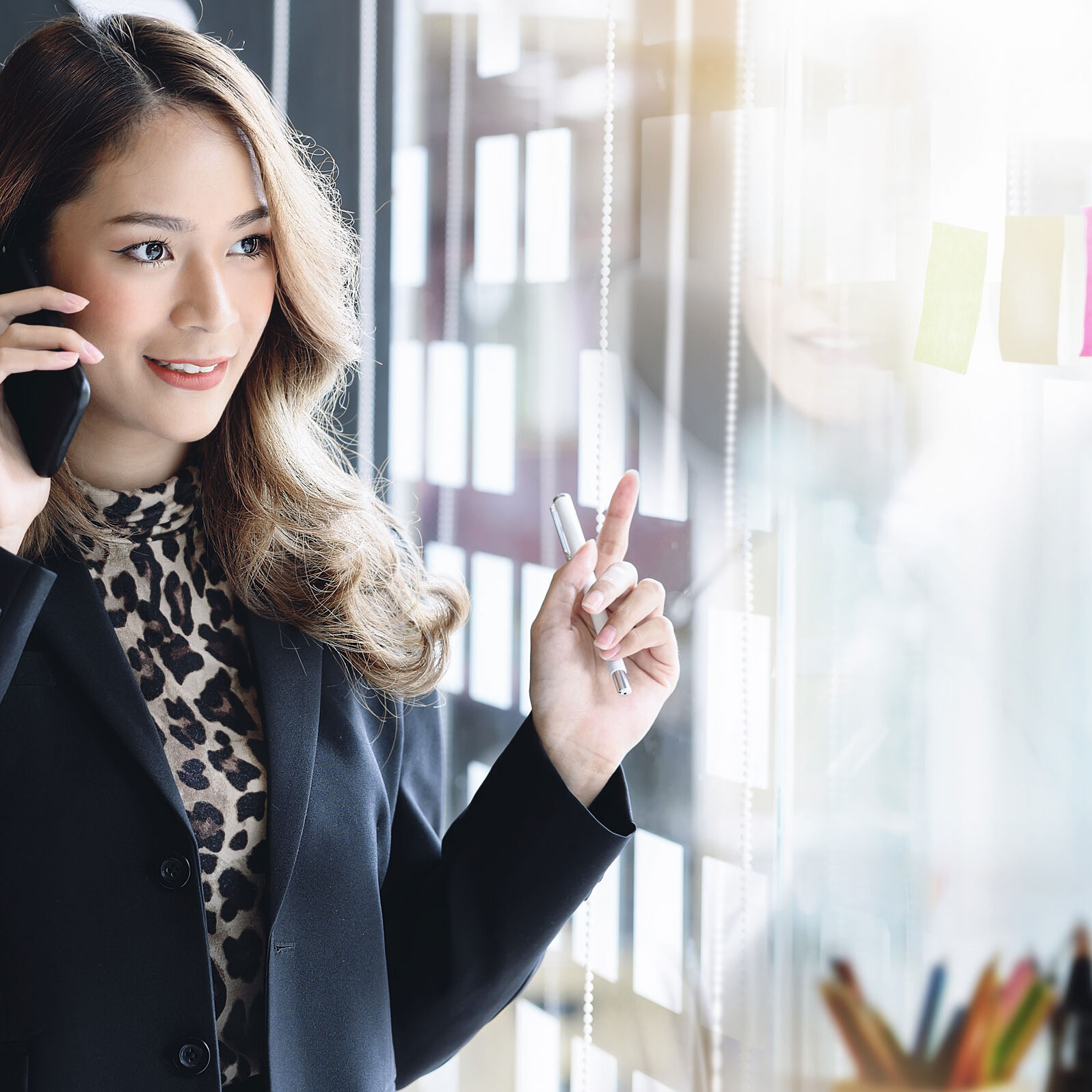 woman at work on phone talking easily